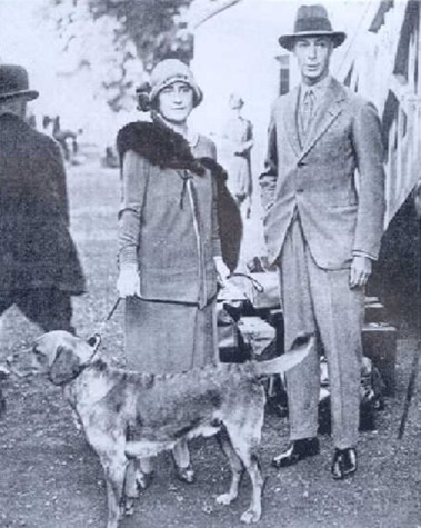 """Prince Albert and his wife Elizabeth Bowes-Lyon with their """"yellow"""" Lab in the 1920s. Source: Wikimedia Commons."""