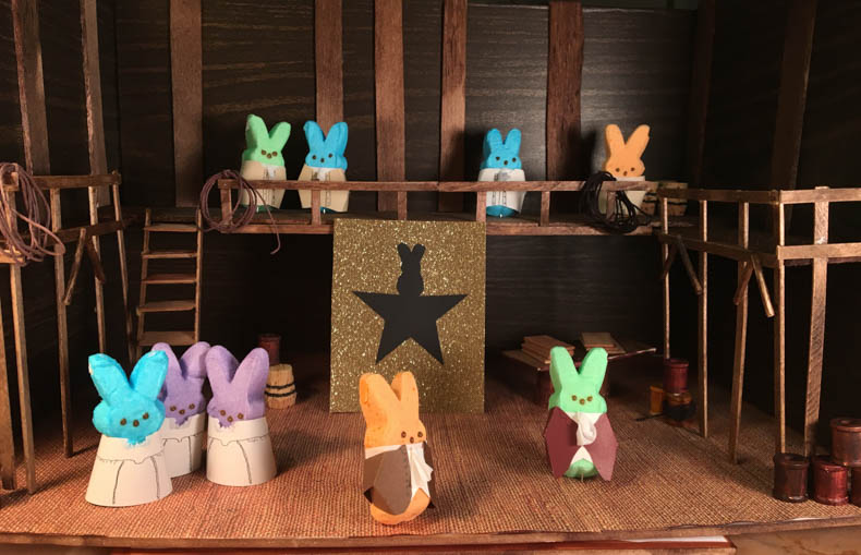 The cast of Hamilpeep stands on their diorama stage.