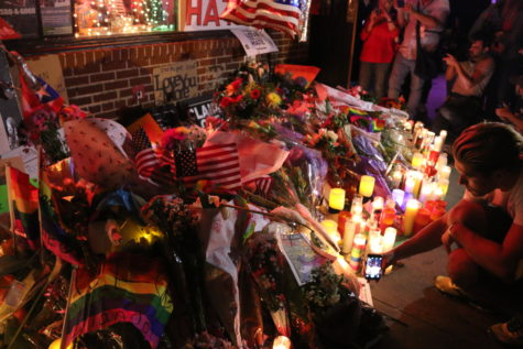 Candlelight vigil in front of the Stonewall Inn for victims of the Pulse nightclub massacre