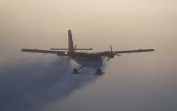 In this 2003 photo, a Twin Otter flies out of the South Pole on a previous medical flight.
