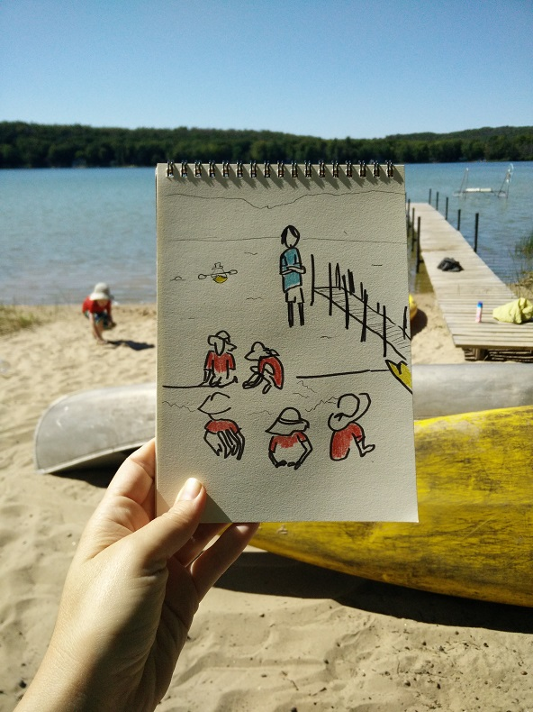 Photo of a drawing of a child playing on the beach